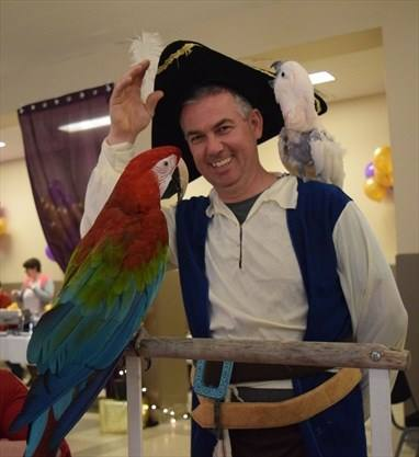 Chris with parrots at Mystic Ball
